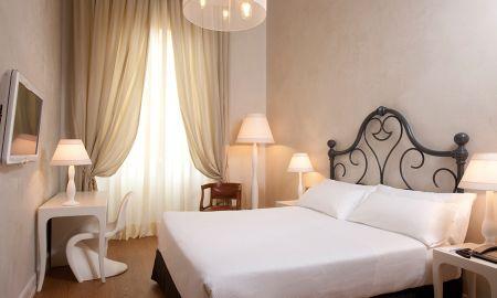 Quarto Premium - Hotel NH Collection Firenze Porta Rossa - Toscana