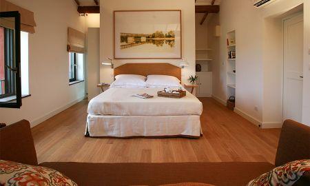 Quarto Duplo com Jardim - Resort Locanda Rossa - Toscana