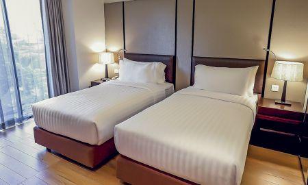 Quarto Twin Deluxe - Arcadia Suites Ploenchit Sukhumvit By Compass Hospitality - Bangkok