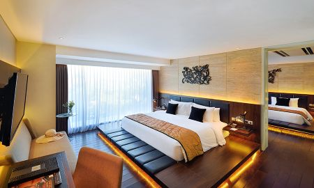 Chambre Deluxe avec baignoire - De Vins Sky Hotel Seminyak - Bali