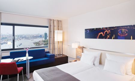 Classic King Room with View - Mövenpick Hotel Amsterdam City Centre - Amsterdam