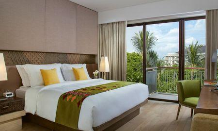 Habitación Clásica King con Vista Piscina - Mövenpick Resort & Spa Jimbaran Bali - Bali