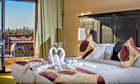 Chambre Supérieure Deluxe - Vue Piscine - Hotel Riad Ennakhil & SPA - Marrakech