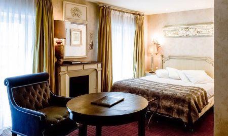 Chambre Deluxe Triple - 2 lits doubles - Hôtel Chateaubriand - Paris