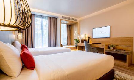 Номер Гранд Делюкс - вид на бассейн - Divalux Resort And Spa Bangkok - Bangkok