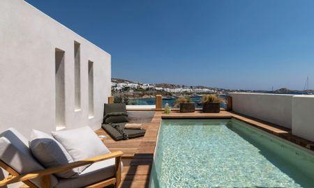 Люкс с панорамным видом на море и гидромассажной ванной на крыше - Kensho Psarou - Mykonos