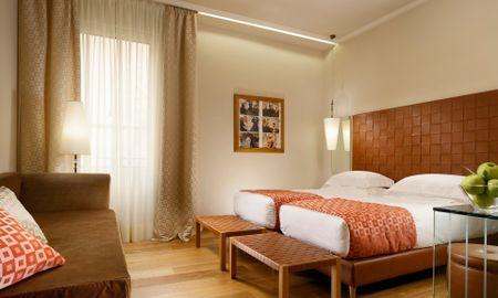 Camera Tripla Premium - Grand Hotel Minerva - Tuscany