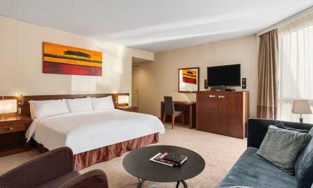 Suite Junior avec Vue sur le Patio - Fairmont Grand Hotel Geneva - Genève
