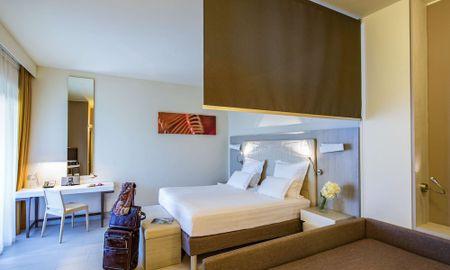 Habitación Superior Executive King - Lado Jardin - Hotel Pullman Timi Ama Sardegna - Cerdeña