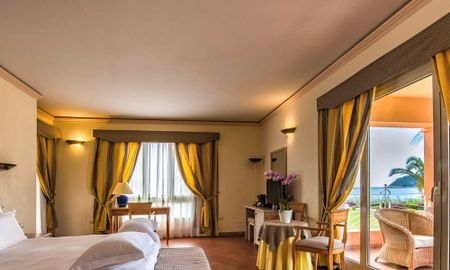 Deluxe King Room - Bay Side - Sofa Bed - Hotel Pullman Timi Ama Sardegna - Sardinia